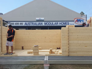 """Australian Modular Homes"" team builds Sicilia backyard cabin display"