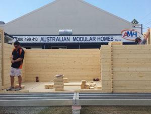 """Australian Modular Homes"" team builds Sicilia backyard cabin display"