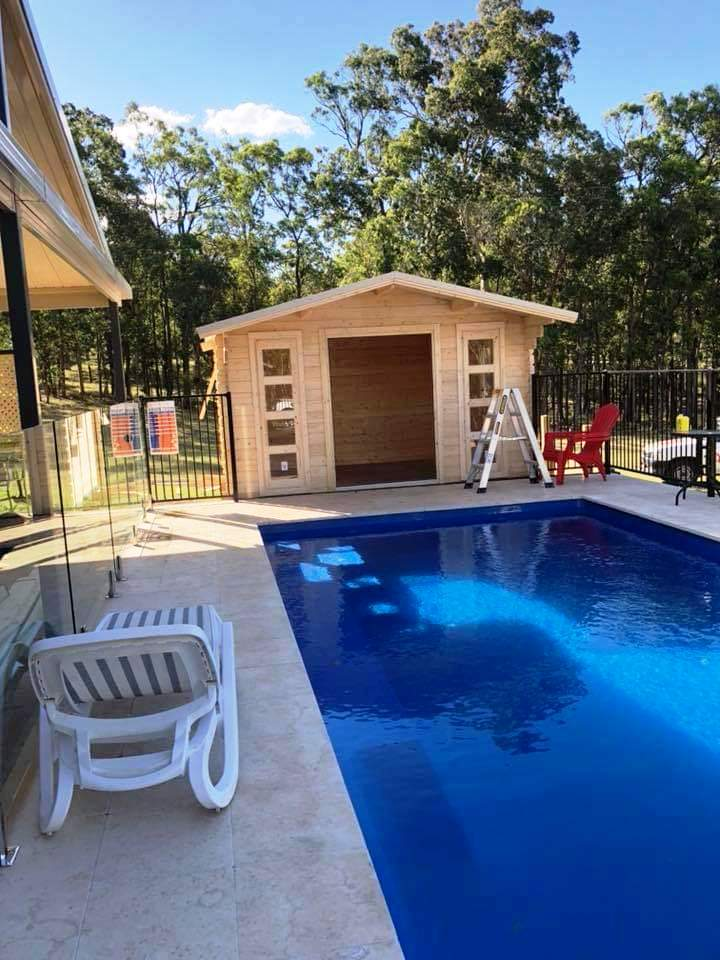 Pool and pool house in backyard, Central Coast