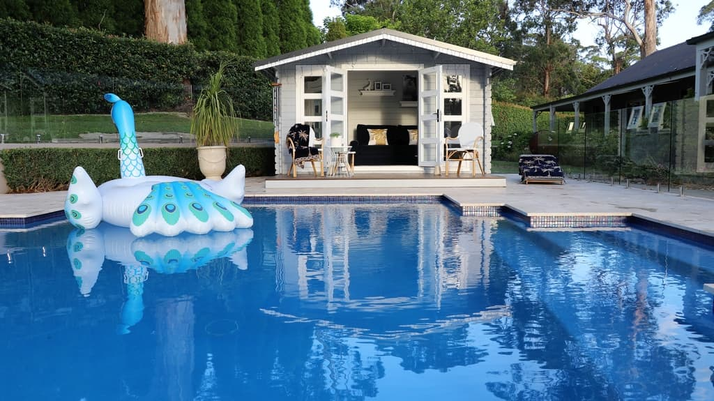 Pool and pool house in backyard Southern Highlands