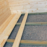 Backyard cabin treated floor frame